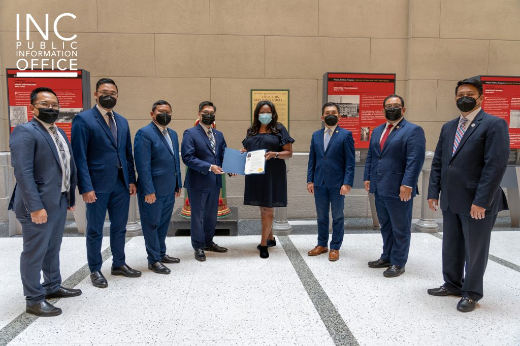 INC Ministers pose with District of Columbia Secretary Kimberly A. Bassett with the congratulatory letter from Washington, D.C. Mayor Muriel Bowser