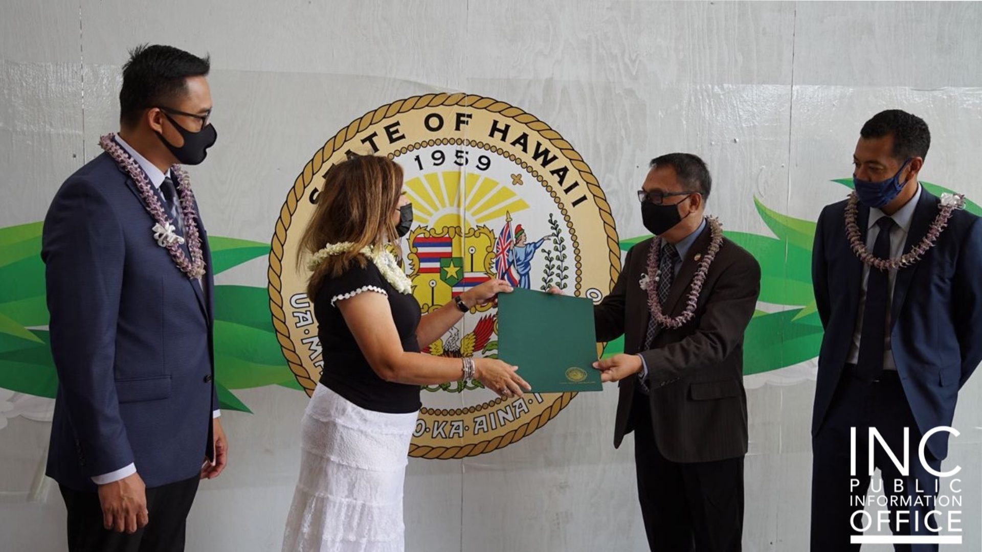 Hawaii State Senator Bennette E. Misalucha offers certificate of recognition to Iglesia Ni Cristo, Church Of Christ Hawaii-Pacific District Supervising Minister, Brother Noel Caritativo.