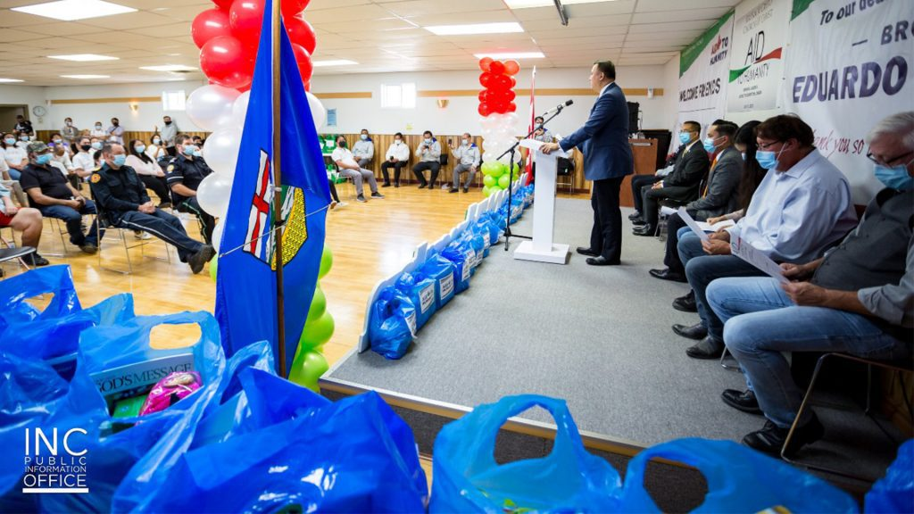 INC Minister of the Gospel Voltaire Tamisin speaks to donation recipients and residents of Manning, Alberta at Royal Canadian Region building during the Aid To Humanity event sponsored by the Iglesia Ni Cristo