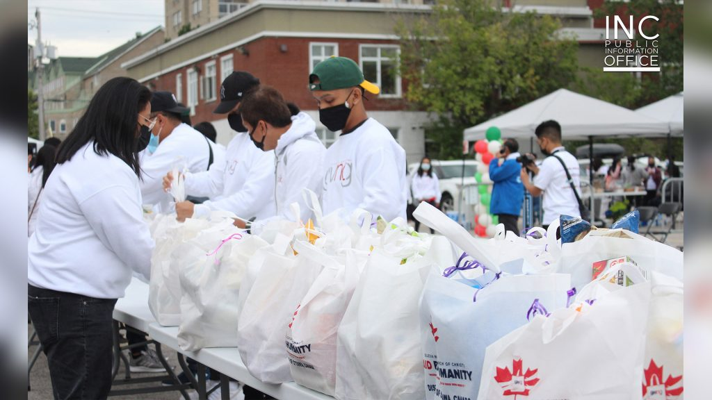 Group of Felix Y. Manalo Foundation volunteers prepare table of free care packages for Gatineau residents Aid To Humanity event of the Iglesia Ni Cristo (Church Of Christ).