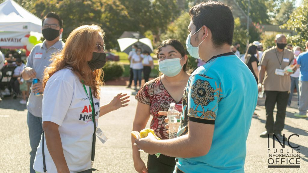 A member of the Iglesia Ni Cristo (Church Of Christ) entertains guests at the Aid To Humanity event.