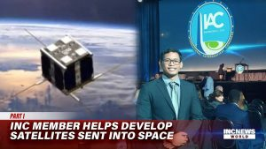 On the left, the Maya-2 satellite in orbit; on the right, a space engineer stands and poses for a photo behind the IAC seal