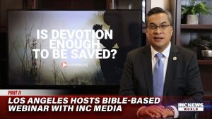 Minister of the gospel standing in front of a TV screen with a webinar presentation behind them.